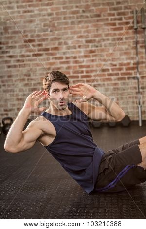 Man doing crunches at the gym