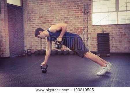 Man lifting kettlebell at the gym