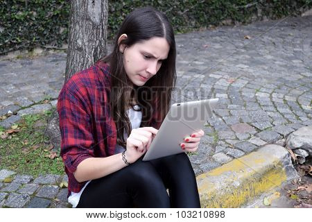 Latin Woman Using A Tablet.
