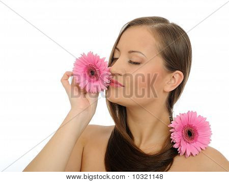 Beautiful Woman With Pure Healthy Skin And Long Hair Smelling 2 Pink Flowers. Isolated On White Back