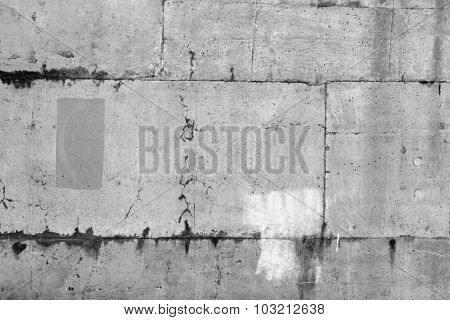 Cracks in grey concrete wall
