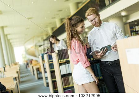 Young Couple In The Library