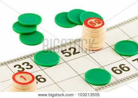 lotto wooden barrels and green chips isolated on a white background