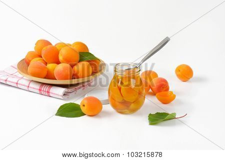 freshly picked and compote apricots in the glass jar
