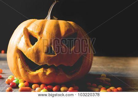 Halloween pumpkin and candies
