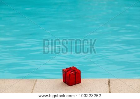 Present Red Box Near Blue Water