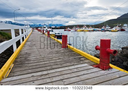 Colorful pier at Dalvik harbor in north Iceland