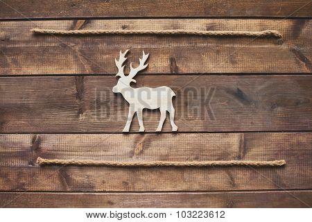 Wooden reindeer between two ropes