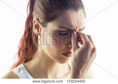 Woman experiencing headache against white background