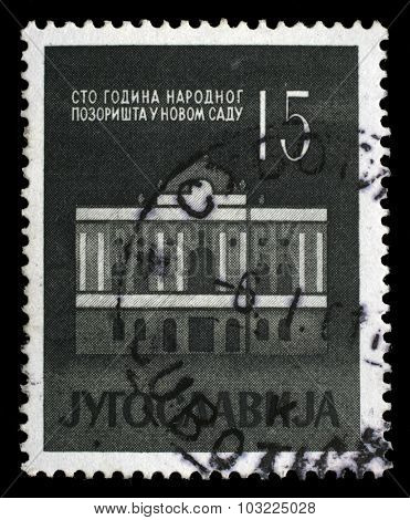 YUGOSLAVIA - CIRCA 1960: A stamp printed in Yugoslavia dedicated to 100 anniversary of the National Theatre in Novi Sad, circa 1960.