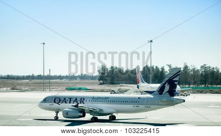Aircraft Airbus A-320 of Qatar Airways is ready to take off from