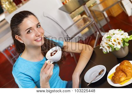 Girl Having A Coffee Break With Heart Shaped Cappuccino