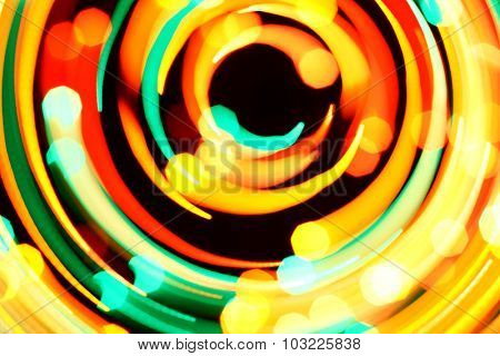 Rotary motion bokeh background of bright lights