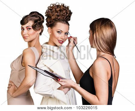 Make-up artist applying liner on model's eyebrows