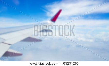 Abstract blur Wing of an airplane flying above the clouds