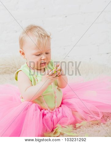 Nice baby holding green apple in hand