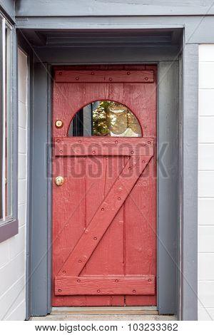 wooden red door with blue trim