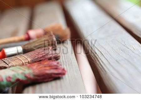 Old brushes on wooden boards