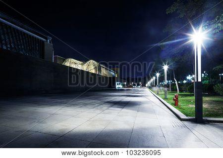 night scene of street and park under lamp light