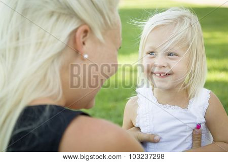 Cute Little Girl Having Fun With Her Mother Outside.