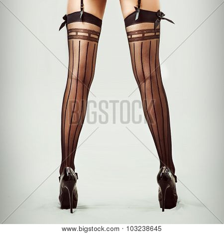 Sexy Long Legs In Stockings Of Beautiful Slim Woman