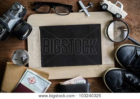 Outfit Of Traveler With Chalkboard And Copy Space On Wooden Backgroun