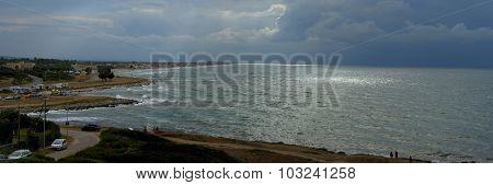 Approaching storm on a beach of Gargano