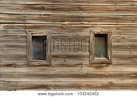 Two Windows In A Wooden Wall