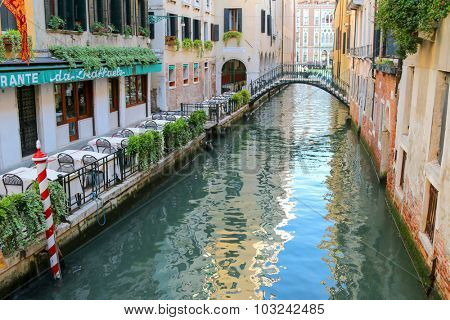 VENICE, ITALY - SEPTEMBER 2014 : The Da Raffaele restaurant and other buildings on the Venetian canals in Venice, Italy on September 14, 2014. There is no roadway in Venice, just canals and boats.