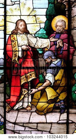 ZAGREB, CROATIA - MAY 28: Jesus and the centurion. Lord, I am not worthy to have you come under my roof..., stained glass in the Basilica of the Sacred Heart of Jesus in Zagreb, Croatia on May 28,2015