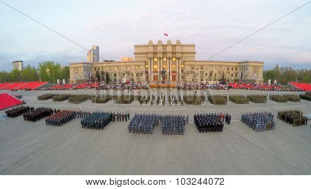 SAMARA - MAY 06, 2015: Formations of soldiers stand on square during rehearsal of parade at spring evening. Aerial view video frame