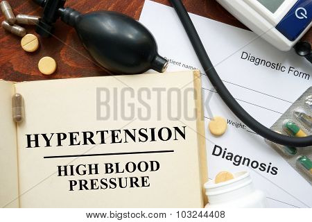 High blood pressure   hypertension written on a book.