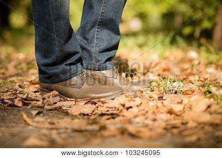 Man's legs in autumn season