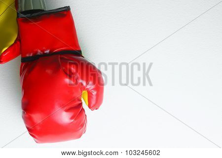 Red leather boxing gloves isolated , Boxing gloves background, popular sport for fighter.