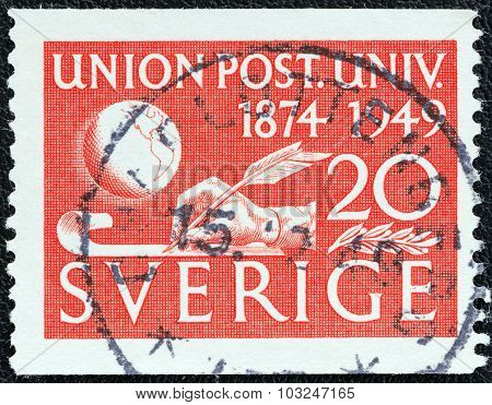 SWEDEN - CIRCA 1949: A stamp printed in Sweden shows Globe and Hand Writing