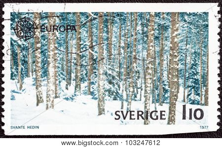 SWEDEN - CIRCA 1977: A stamp printed in Sweden shows winter forest scene