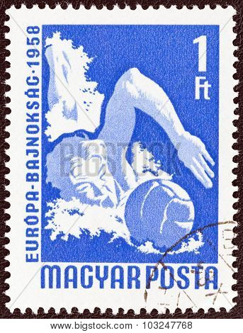 HUNGARY - CIRCA 1958: A stamp printed in Hungary shows water polo player