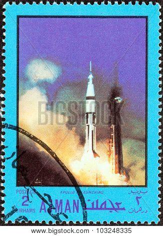 AJMAN EMIRATE - CIRCA 1970: Stamp shows Apollo VII launching