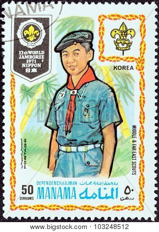 MANAMA DEPENDENCY - CIRCA 1971: Stamp shows boy scout from Korea