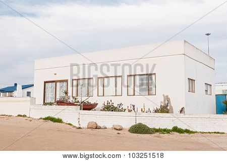 House With A Boat Used As Planter In Hondeklipbaai