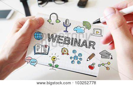 Mans Hand Drawing Webinar Concept On Notebook