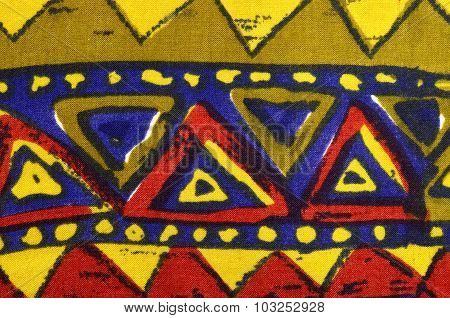 Close Up On Triangles In A Row On Colorful Fabric.