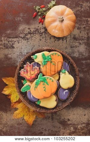 Thanksgiving cookies  and squash  on rustic table