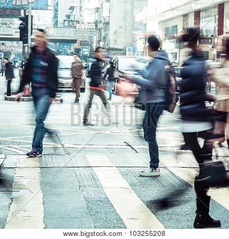 People Moving On Zebra Crosswalk At Crowded City. Hong Kong