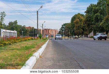 Central street of small Ukrainian town Kotelva at autumnal weekend