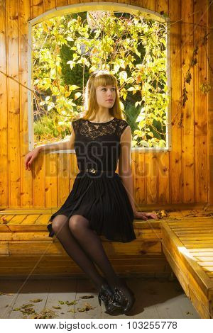 Pretty Blonde Sitting In The Arbor