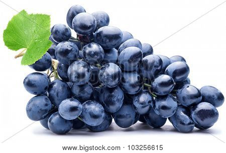 Purple grape with green leaf isolated on white background.