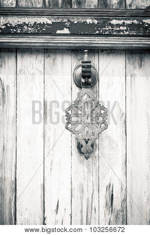 Black And White Shot Of An Oriental  Door Knocker