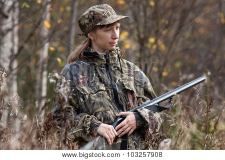 Woman Hunter In Autumn Forest