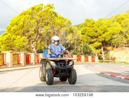 Tossa de Mar. A man on a quad bike.
